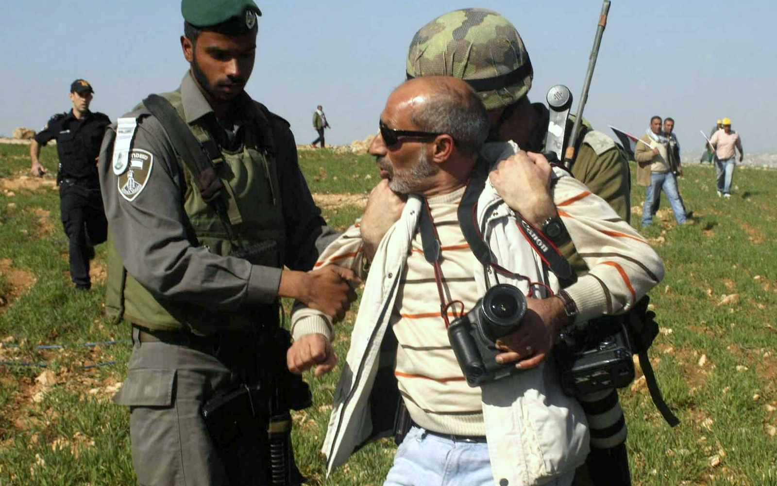 Israeli security detain The Associated Press photographer Nasser Shiyoukhi during a Palestinian protest in Yatta in the West Bank on Saturday. Shiyoukhi was released without charge after Saturday's incident. (photo credit: AP Photo)