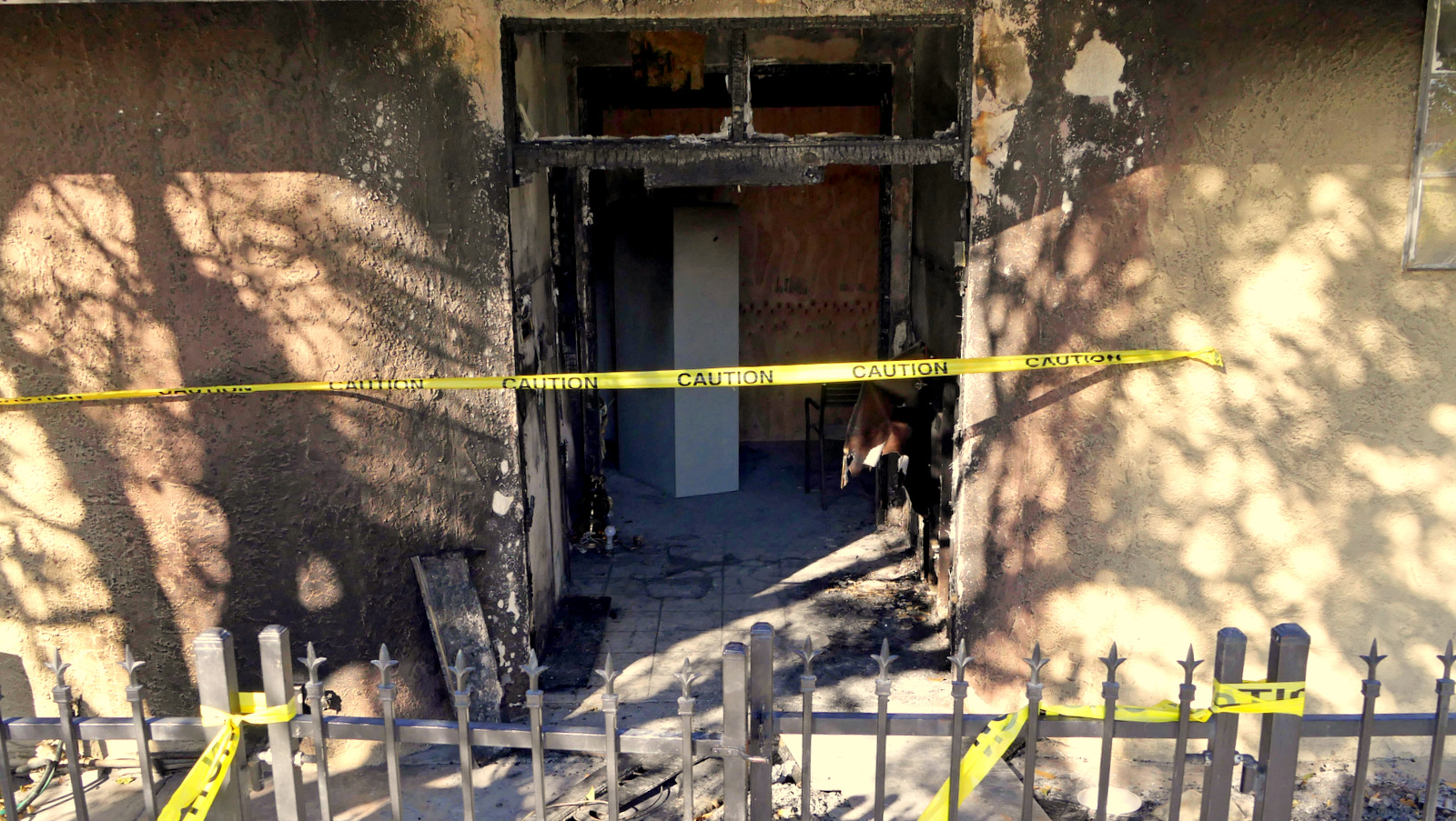 Police tape marks off the burned front lobby of the Islamic Center of Palm Springs in Coachella, Calif., on Saturday, Dec. 12, 2015. Flames were reported just after noon on Friday. The fire was contained to the small building's front lobby, and no one was injured. (AP Photo/David Martin)