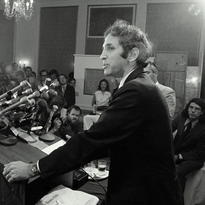 Dr. Daniel Ellsberg faces a battery of microphones at a news conference in Cambridge on Thursday, July 1, 1971. Ellsberg charged that government secrecy has led to the deaths of 50,000 Americans in Vietnam. (AP Photo)