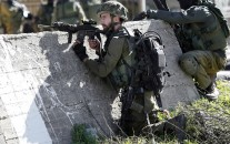 Israeli soldiers during their early morning raid on Amari Palestinian refugee camp, near the West Bank city of Ramallah. Monday, Feb. 15, 2016. (AP Photo/Nasser Shiyoukhi).