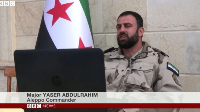 Top Image: If Major Yaser Abdulrahim looks like he's never worn his FSA uniform out into the field, that's because he hasn't. He is not a member of the FSA at all, and is instead a commander of the Fatah Halab, an umbrella group for Al Qaeda affiliates armed and funded by both the US and Saudi Arabia.