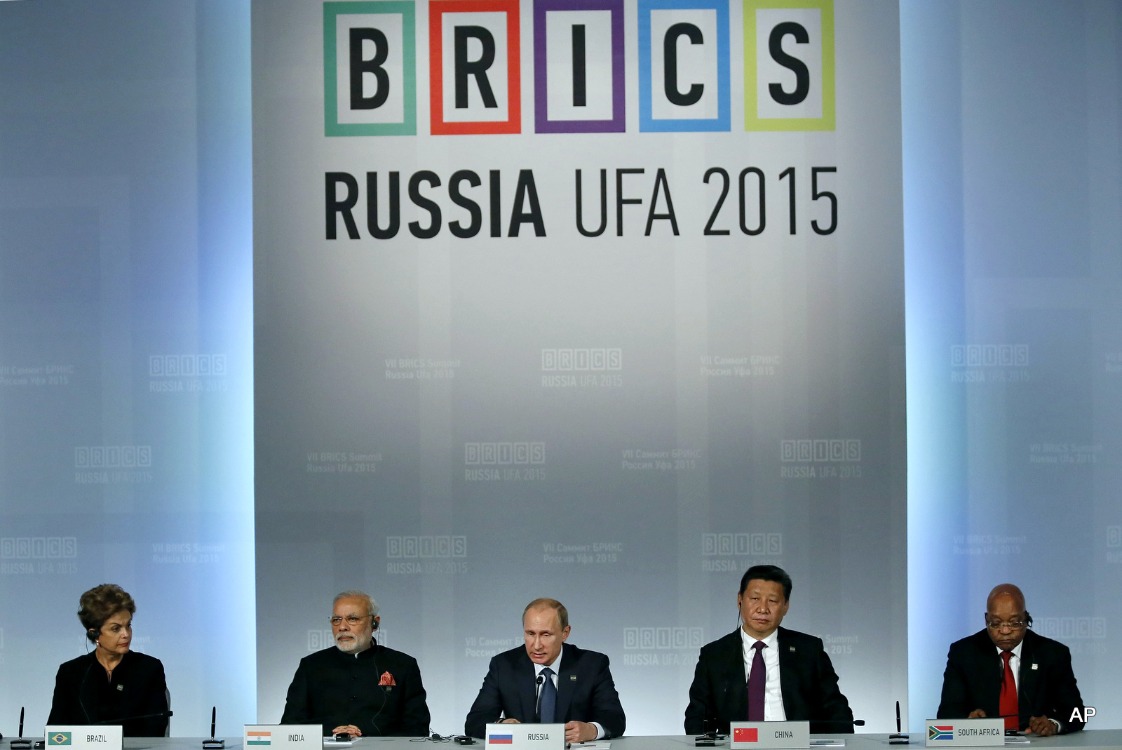 From left: Brazil's President Dilma Rousseff , Indian Prime Minister Narendra Modi, President of Russia Vladimir Putin, President of China Xi Jinping and South African President Jacob Zuma sit during a signing ceremony at the BRICS Summit in Ufa, Russia, Thursday, July 9, 2015. Ufa is hosting BRICS (Brazil, Russia, India, China and South Africa) and SCO (Shanghai Cooperation Organisation) summits. (Sergei Ilnitsky/Pool photo via AP)