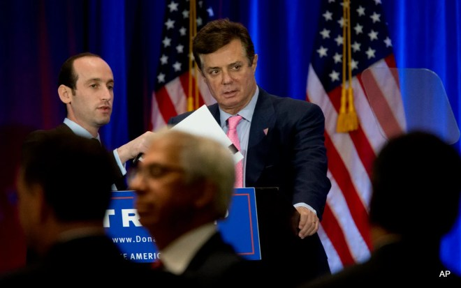 Paul Manafort, right, and Stephen Miller, senior policy adviser for Republican presidential candidate Donald Trump appear on stage ahead of Trump's speech, Wednesday, June 22, 2016, in New York.
