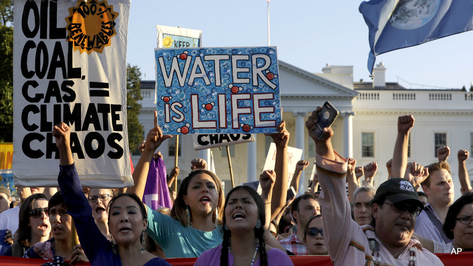 Supporters of the Standing Rock Sioux Tribe rally in opposition of the Dakota Access oil pipeline in front of the White House, Tuesday, Sept. 13, 2016, in Washington.