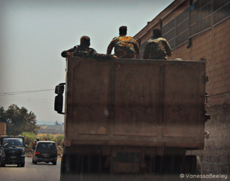 Syrian Arab Army soldiers travelling to war via the road to Aleppo. (Photo by Vanessa Beeley.)