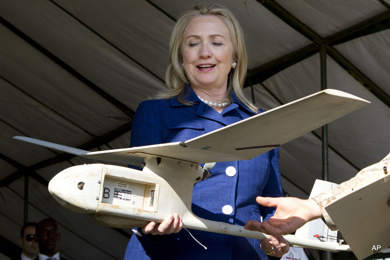 Secretary of State Hillary Rodham Clinton holds a small U.S.-made drone that the Ugandan military uses in Somalia to fight al-Qaida linked militants, Friday, Aug. 3, 2012, during a demonstration and briefing at Kasenyi Military Base in Kampala, Uganda.