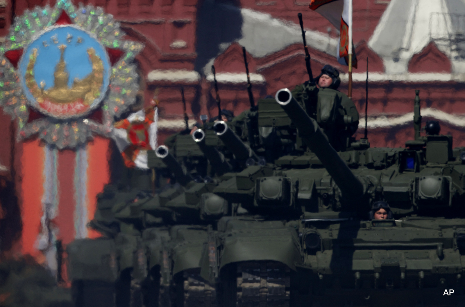 Russian army soldiers drive their tanks along the Red Square during a general rehearsal for the Victory Day military parade.