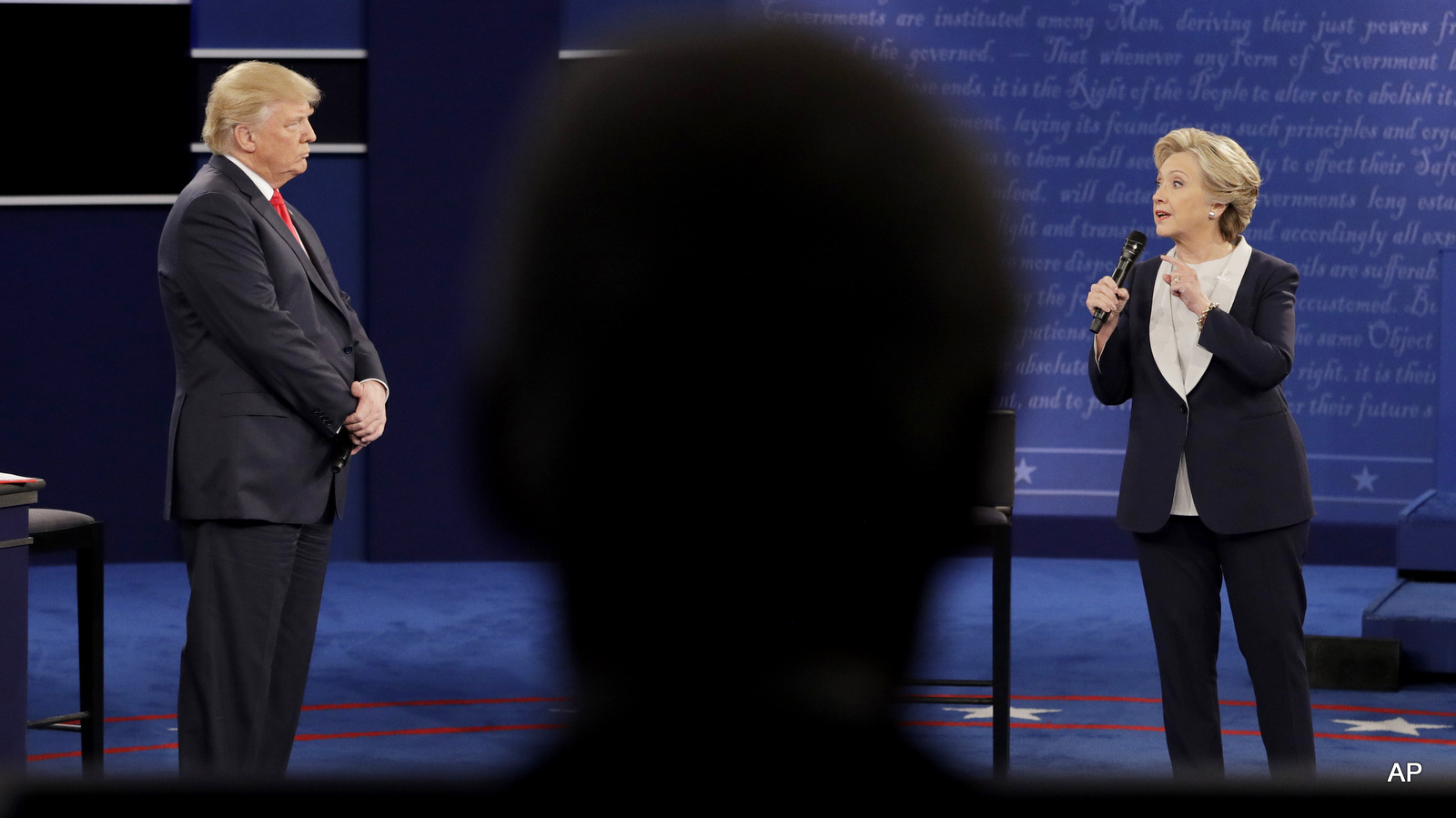 Bill Clinton, in foreground, watches the second presidential debate between Democratic presidential nominee Hillary Clinton and Republican presidential nominee Donald Trump at Washington University, Sunday, Oct. 9, 2016, in St. Louis.