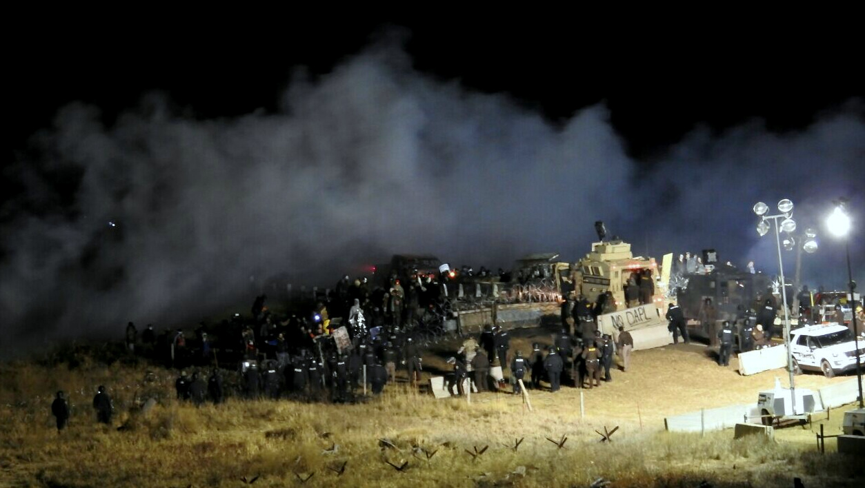 In this image provided by Morton County Sheriff's Department, law enforcement and protesters clash near the site of the Dakota Access pipeline on Sunday, Nov. 20, 2016, in Cannon Ball, N.D. (Morton County Sheriff's Department via AP)