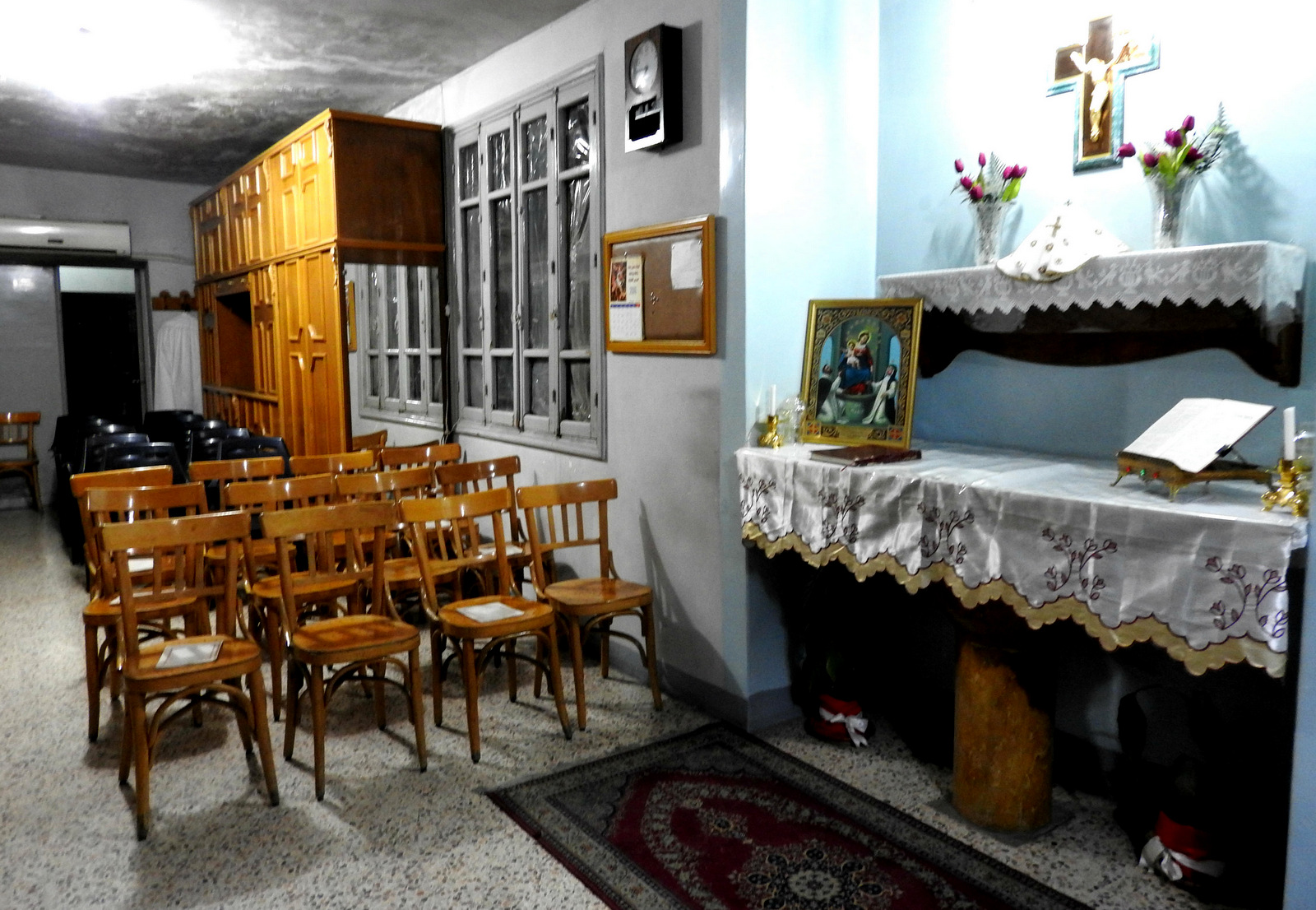 According to a representative of the Syrian Catholic Church of Aleppo, around one-third of the congregation's 1,350 families have fled to other areas of Syria or even gone abroad, primarily seeking security and distance from the mortars and rockets of terrorist factions. Congregation members stopped worshiping in the church chapel two years ago after repeated instances of shelling. They now gather in a small interior corridor where they feel somewhat safer. Nov. 2, 2016. (Photo: Eva Bartlett)
