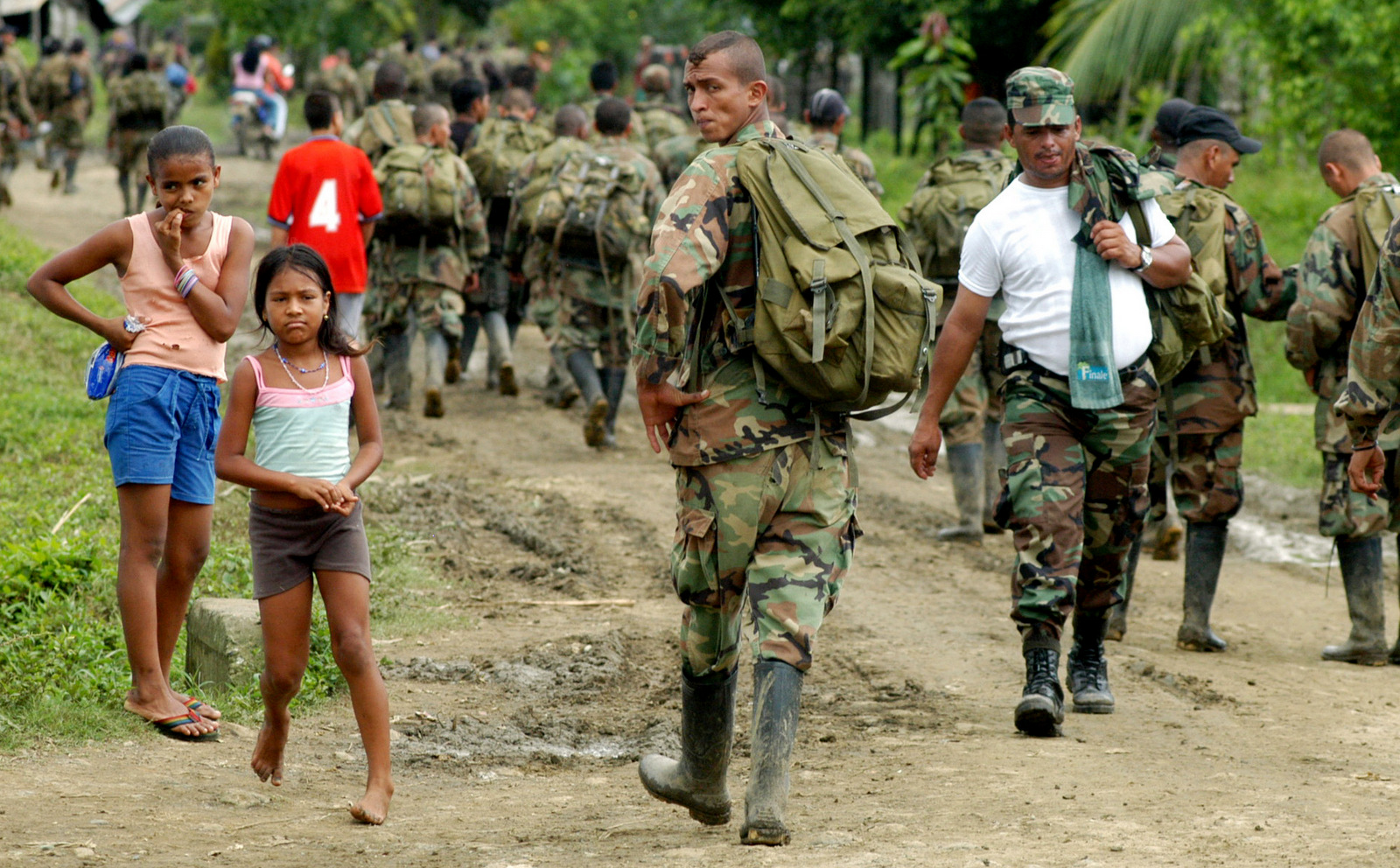 In this photograph provided by the El Tiempo newspaper, paramilitary fighters of the