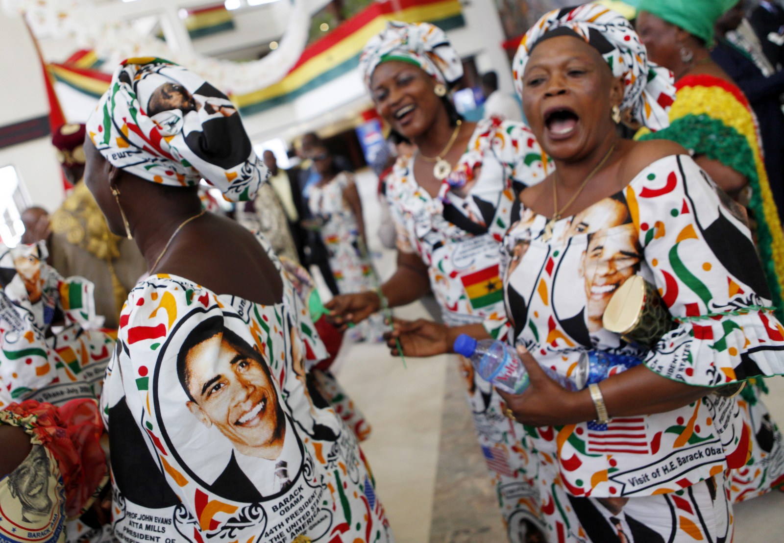 Women wearing traditional dresses bearing the image of President Barack Obama chant his name after he addressed the Ghanaian Parliament in Accra, Ghana,, July 11, 2009. (AP/Charles Dharapak)