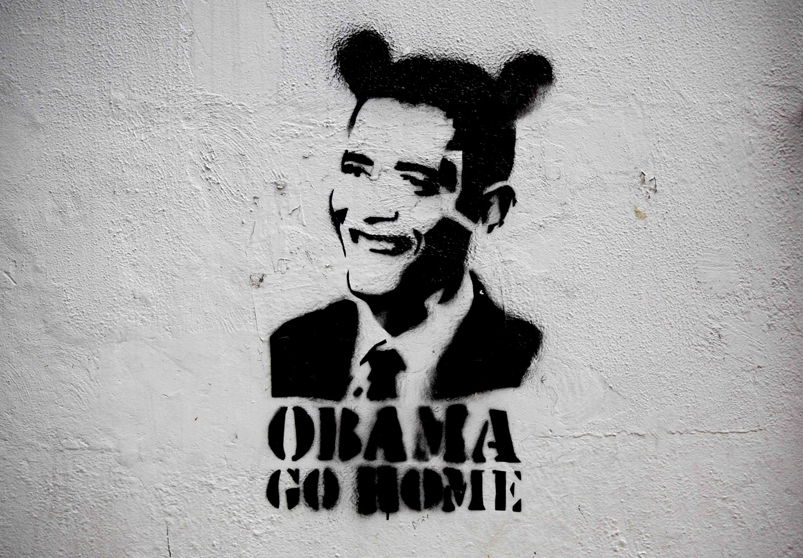 "An image of President Barack Obama wearing fake ears and the slogan ""Obama go home"" on a street wall in Caracas, Venezuela. Venezuelan President Nicolas Maduro regularly sets social media afire with support, with heavily trending anti-U.S. campaigns such #ObamaYankeeGoHome and #ObamaRepealTheExecutiveOrder, which denounced U.S. sanctions on members of Maduro's administration. (AP/Ariana Cubillos)"