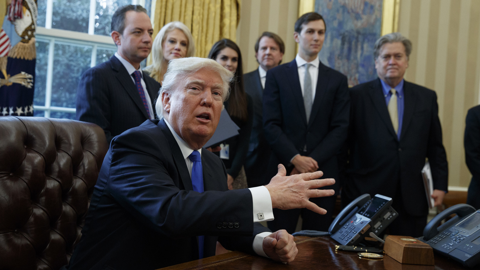 President Donald Trump talks with reporters n the Oval Office of the White House in Washington, Tuesday, Jan. 24, 2017, before signing an executive order on the Keystone XL pipeline. (AP/Evan Vucci)