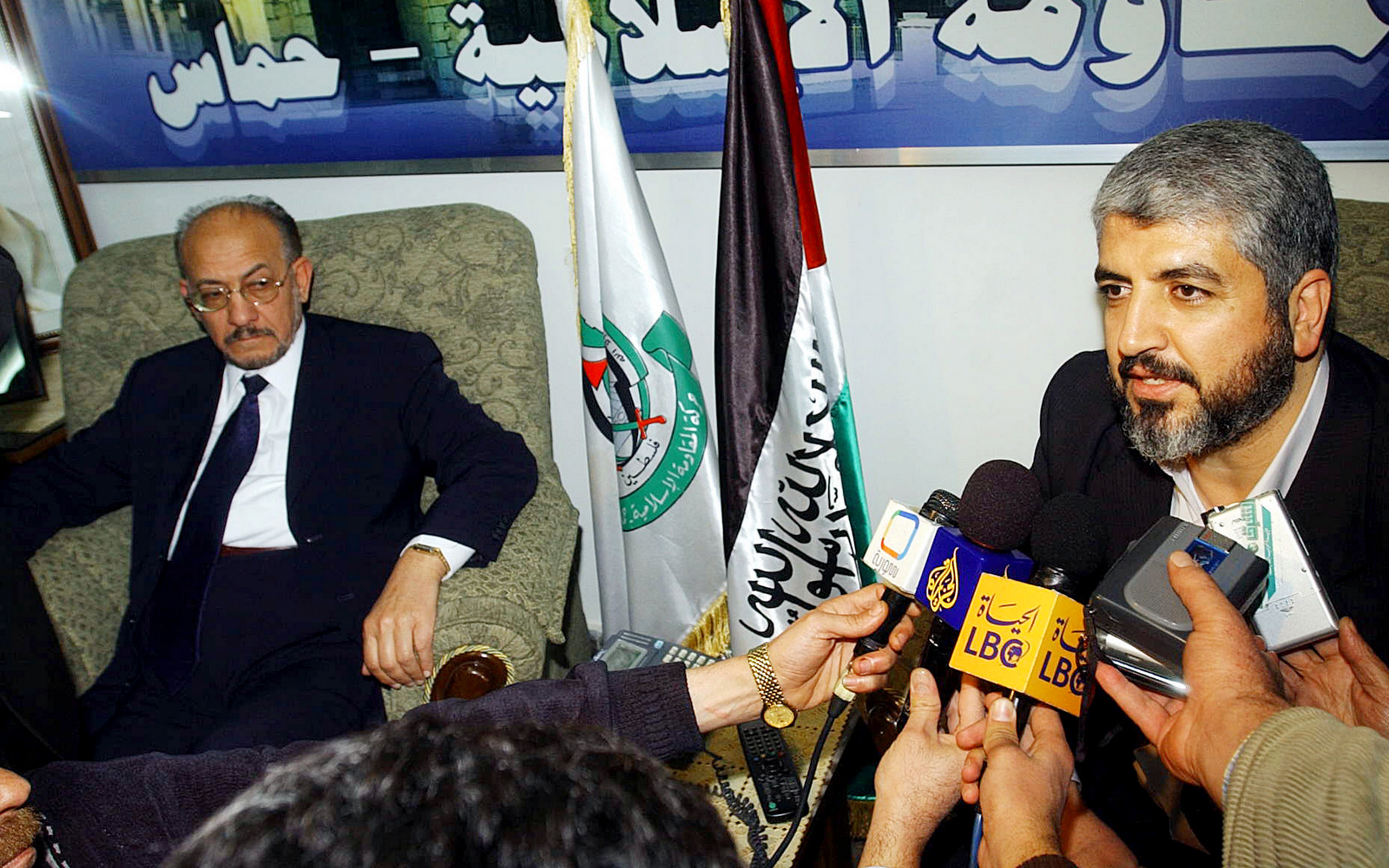 Highly ranking Muslim Brotherhood official Abdul-Majeed Zneibat, left, listens as Hamas leader Khaled Mashaal, right, talks to reporters in Damascus, Tuesday Jan, 31, 2006 . (AP/Bassm Tellawi).