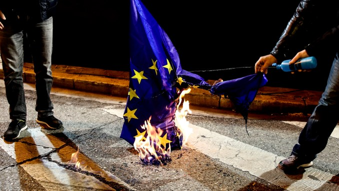 Supporters of the communist-affiliated union PAME burn a EU flag during an anti-austerity rally in Athens, Wednesday, Mar. 1, 2017. (AP/Yorgos Karahalis)
