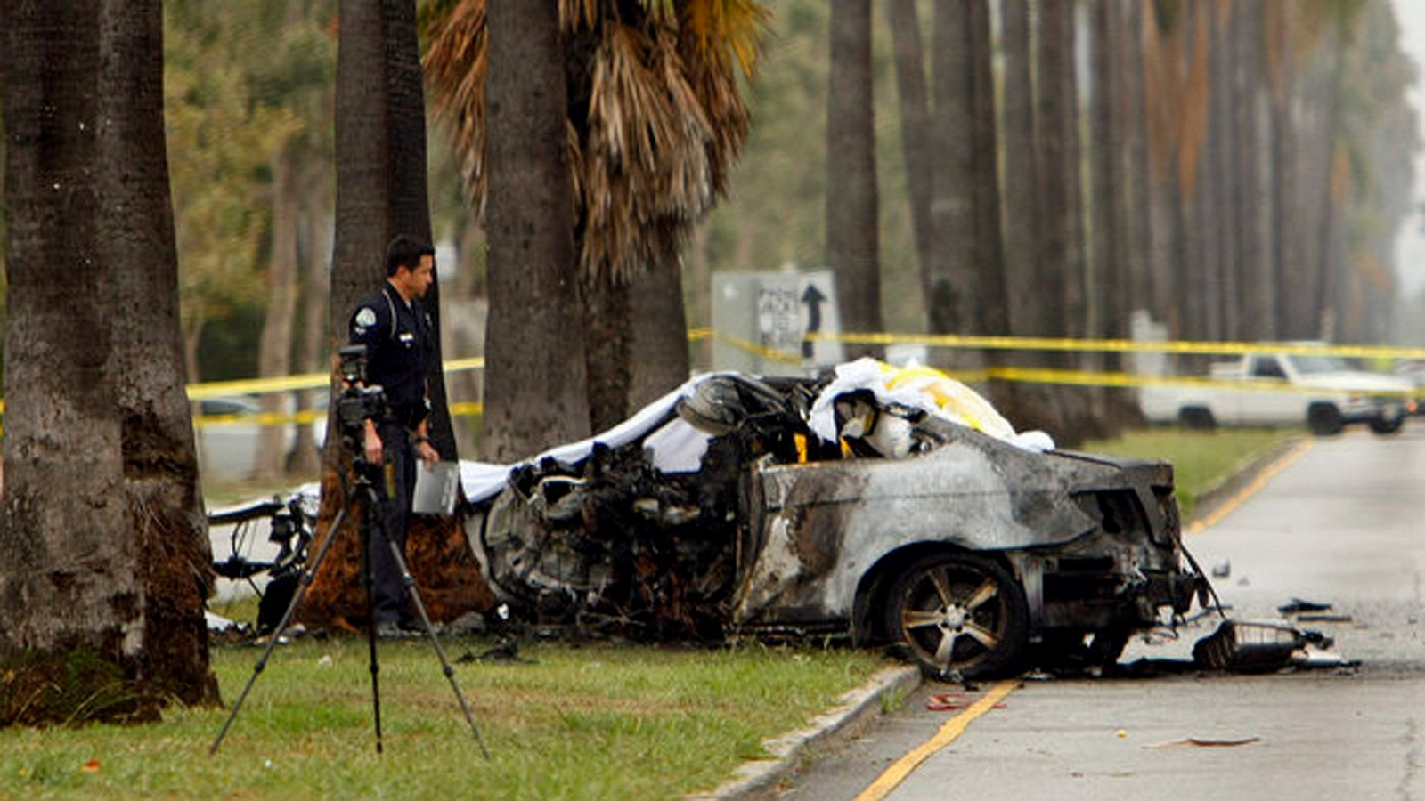 An LAPD officer investigates the scene of a single-vehicle accident in which journalist Michael Hastings was killed. (Photo: Al Seib/LA Times)