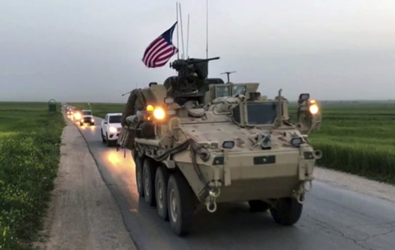 This Friday, April 28, 2017 still taken from video, shows U.S. forces patrolling on a rural road in the village of Darbasiyah, in northern Syria. (AP via APTV)