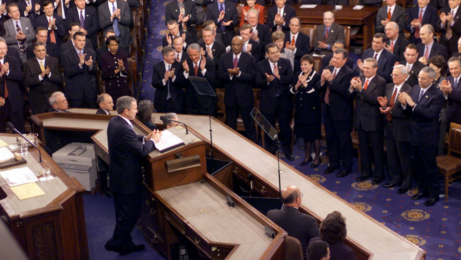 "President Bush gives his State of the Union address on Capitol Hill Tuesday, Jan. 29, 2002. Bush fleshed out his vision for the war on terrorism beyond Afghanistan, to a dozen countries that he said harbor terrorists and ""an axis of evil"" of three more that seek weapons of mass destruction, including Syria. (AP/J.Scott Applewhite)"