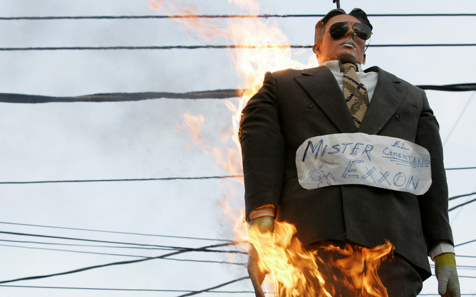 """An effigy representing Judas Iscariot, with a sign that labels it also as """"Mr. Exxon"""", referred to the Texas-based Exxon Mobil oil corporation, is burned during Holy Week in Caracas, March 23, 2008. (AP/Howard Yanes)"""