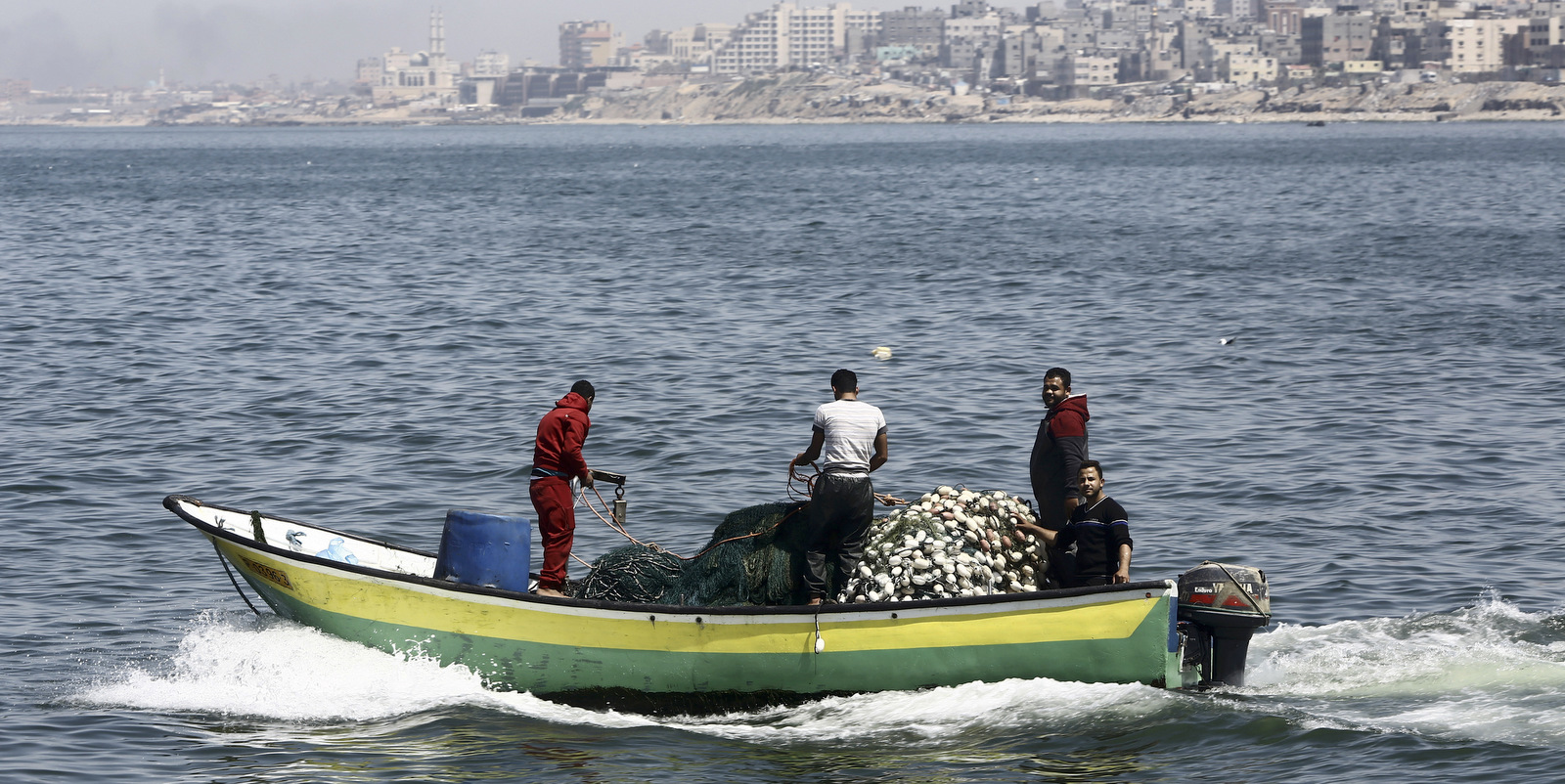 Fishermen ride their boat into the waters of the Mediterranean Sea near Gaza City, April 6, 2017. (AP/Adel Hana)