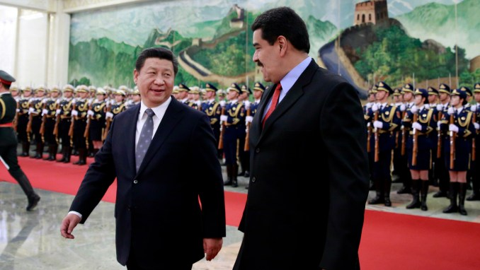 Venezuela's President Nicolas Maduro, right, chats with Chinese President Xi Jinping after a welcome ceremony at the Great Hall of the People in Beijing, China Wednesday, Jan. 7, 2015. (AP/Andy Wong)