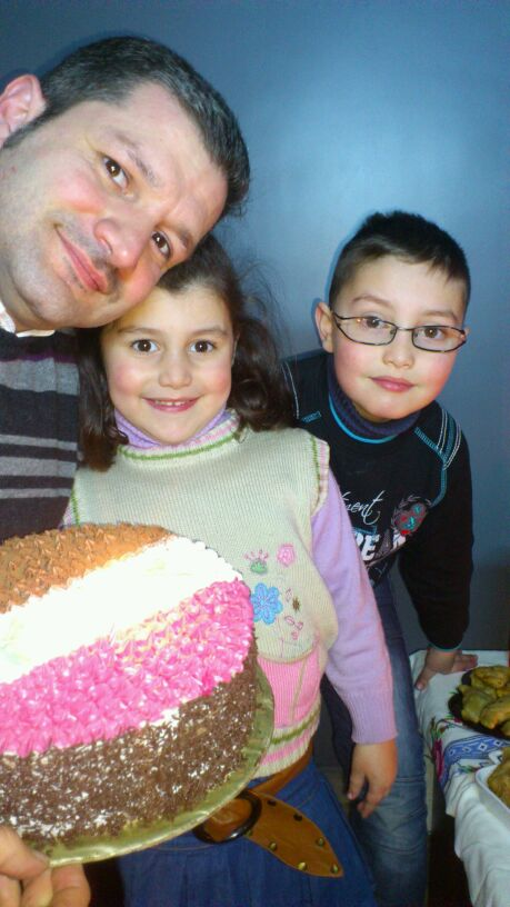 The Hajjo family celebrates Abed Hajjo's birthday in their Aleppo home, 2012. Taken by his late wife Camilia, the photo shows Abed and his children Jameel and Julie.