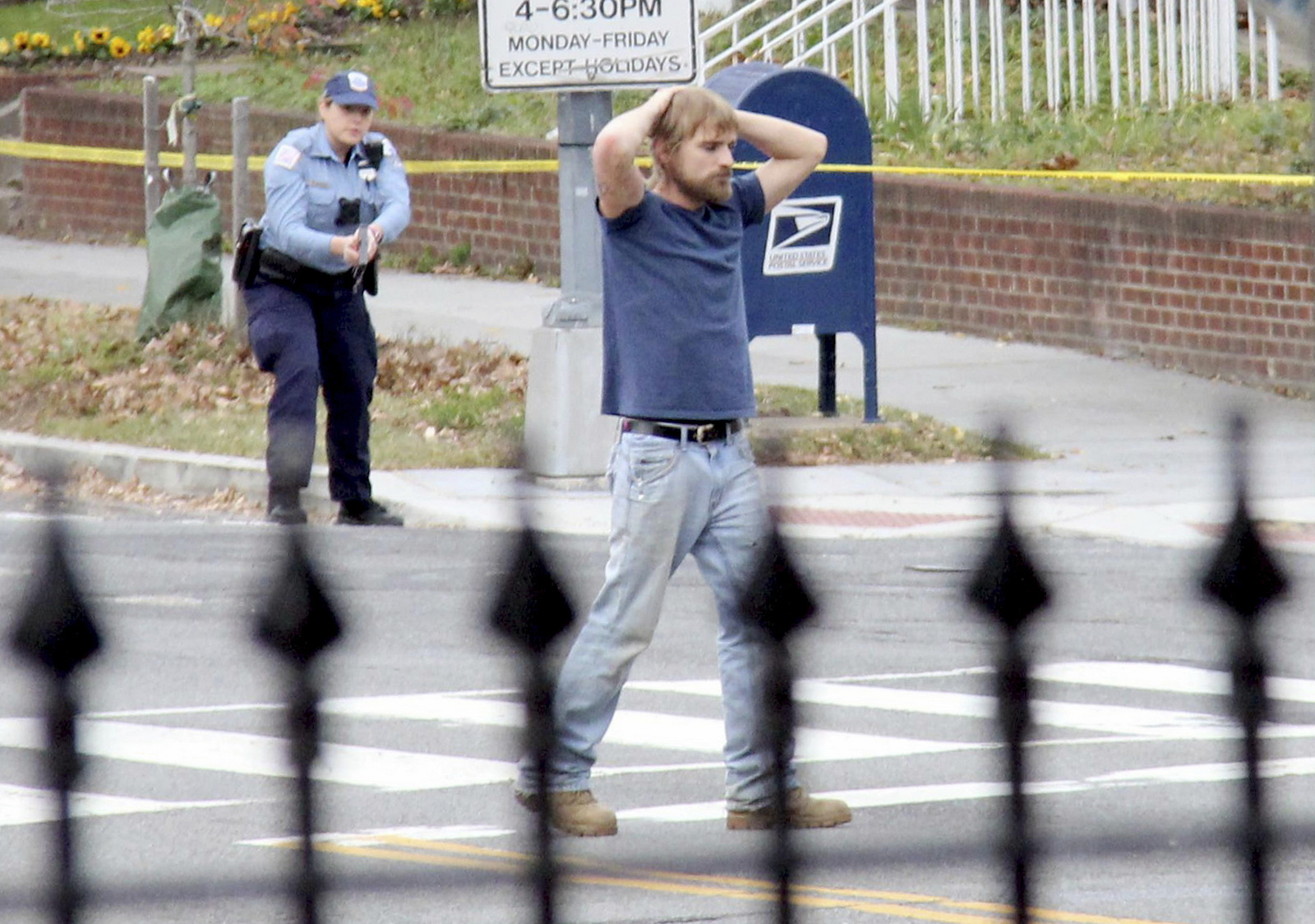"""FILE - In this Dec. 4, 2016 file photo, Edgar Maddison Welch, 28 of Salisbury, N.C., surrenders to police in Washington. Welch, a man who police said was inspired by false internet rumors dubbed """"pizzagate"""" to fire an assault weapon inside a Washington pizzeria. March 24, 2017 (Sathi Soma/AP)"""