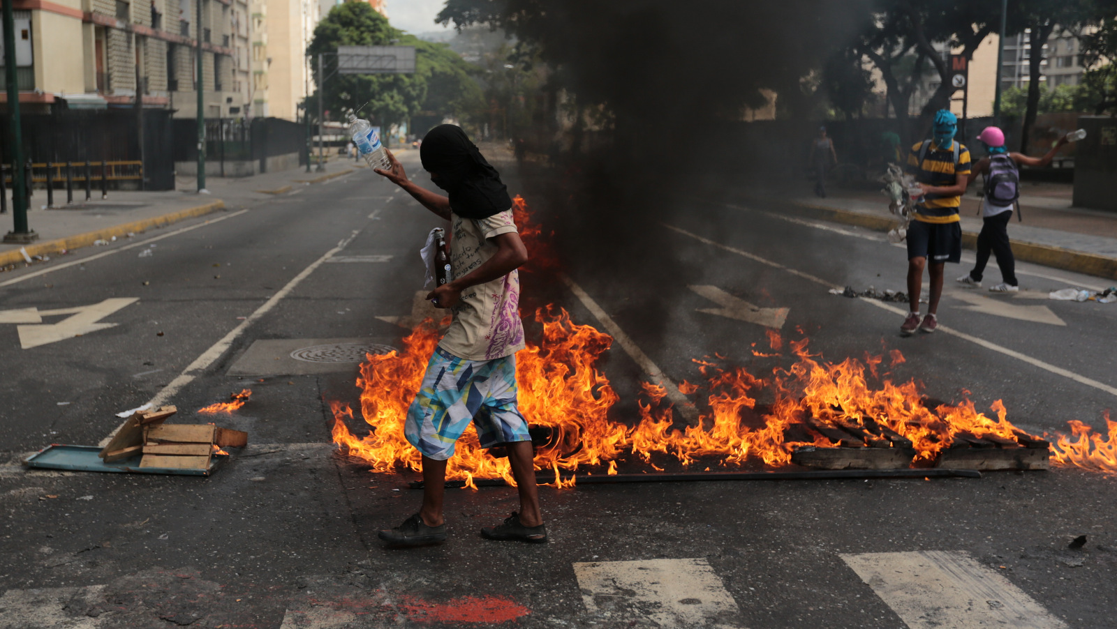 Anti-government protesters oversee a burning barricade in Caracas, Venezuela, June 26, 2017. (AP/Fernando Llano)