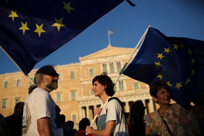 Greek Protesters hold European flags during an anti government rally outside the Greek parliament, central Athens, June 20 , 2017. (AP/Petros Giannakouris)