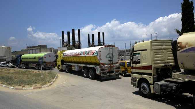 Egyptian trucks carrying fuel enter Gaza's power plant in Nusseirat, in the central Gaza Strip, Wednesday, June 21, 2017. Egypt trucked 1 million liters of cheap diesel fuel to the Gaza Strip's sole power plant — a rare shipment that temporarily eased a crippling electricity crisis enclave but also appeared to undercut Palestinian President Mahmoud Abbas. (AP/Adel Hana)