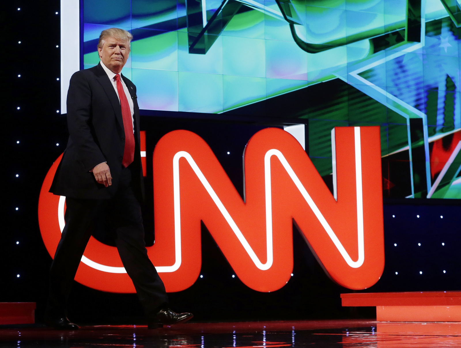 Donald Trump enters the debate hall during the Republican presidential debate sponsored by CNN, March 10, 2016. (AP/Alan Diaz)