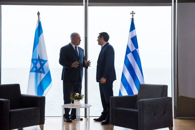 Israeli Prime Minister Benjamin Netanyahu, left, talks with Greek Prime Minister Alexis Tsipras during their meeting in Thessaloniki, Greece's second largest city on Thursday, June 15, 2017. Under heavy security Netanyahu is in northern Greece to discuss plans to become a key supplier of European energy through an ambitious Mediterranean undersea natural gas pipeline project. (AP/Giannis Papanikos)