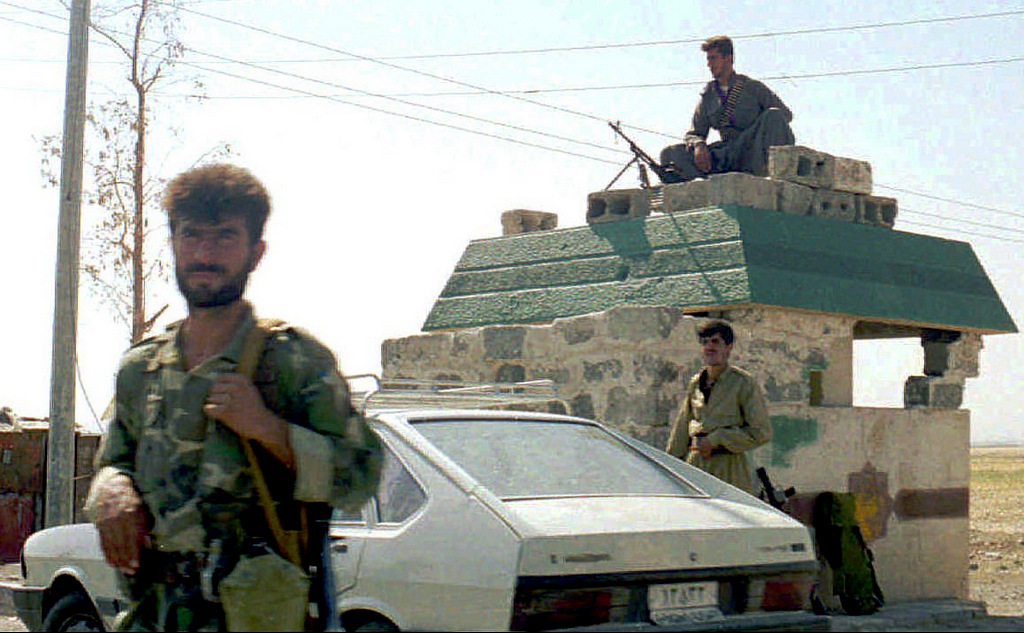 Kurdish guerrillas of the Kurdistan Democratic Party, guard the entrance of Irbil, Iraq, Sept. 1, 1996, after they seized the main Kurdish city from the rival Patriotic Union of Kurdistan on, Aug. 31, 1996. Iraqi President Saddam Hussein's forces stormed Irbil to dislodge one Kurdish group, the Patriotic Union of Kurdistan, and allow its rival, the KDP, to move in. Internal quarrels have long plagued the estimated 20 million Kurds who live in the mountainous region where the borders of Syria, Turkey, Iraq, Iran, Armenia and Azerbaijan converge. (AP/Anatolia)