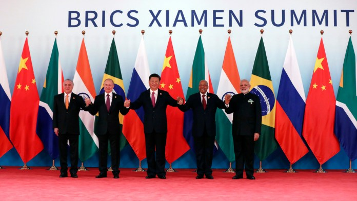 From left, Brazil's President Michel Temer, Russian President Vladimir Putin, Chinese President Xi Jinping, South Africa's President Jacob Zuma and Indian Prime Minister Narendra Modi pose for a group photo during the BRICS Summit at the Xiamen International Conference and Exhibition Center in Xiamen, southeastern China's Fujian Province, Sept. 4, 2017. (Wu Hong/AP)
