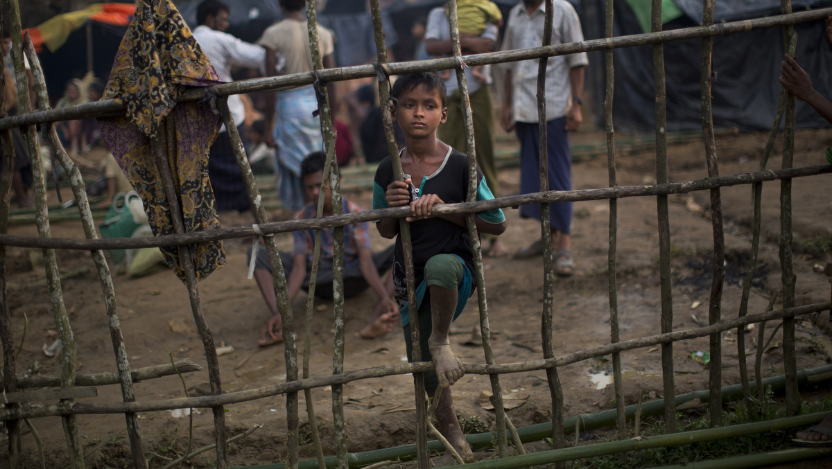 A Rohingya child, newly arrived from Myanmmar to the Bangladesh side of the border, stands by a wooden fence at Kutupalong refugee camp in Ukhia, Sept. 5, 2017. Bangladesh, one of the world's poorest countries, was already sheltering some 100,000 Rohingya refugees before another 123,000 flooded in after Aug. 25, according to the U.N. refugee agency's latest estimate on Tuesday. (AP/Bernat Armangue)