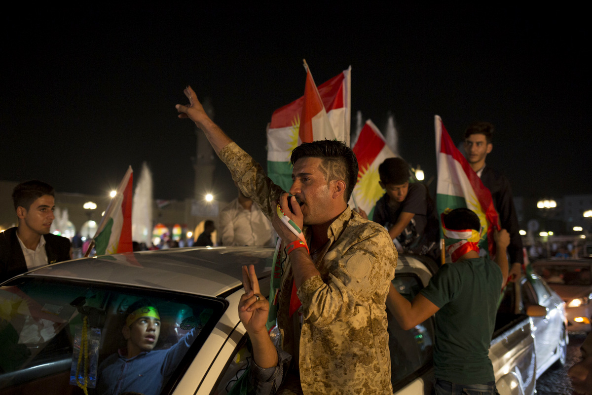 A man with 'yes' shaved into his hair chants through a speaker in the streets of Irbil after polling stations closed on Monday, Sept. 25, 2017. (AP/Bram Janssen)