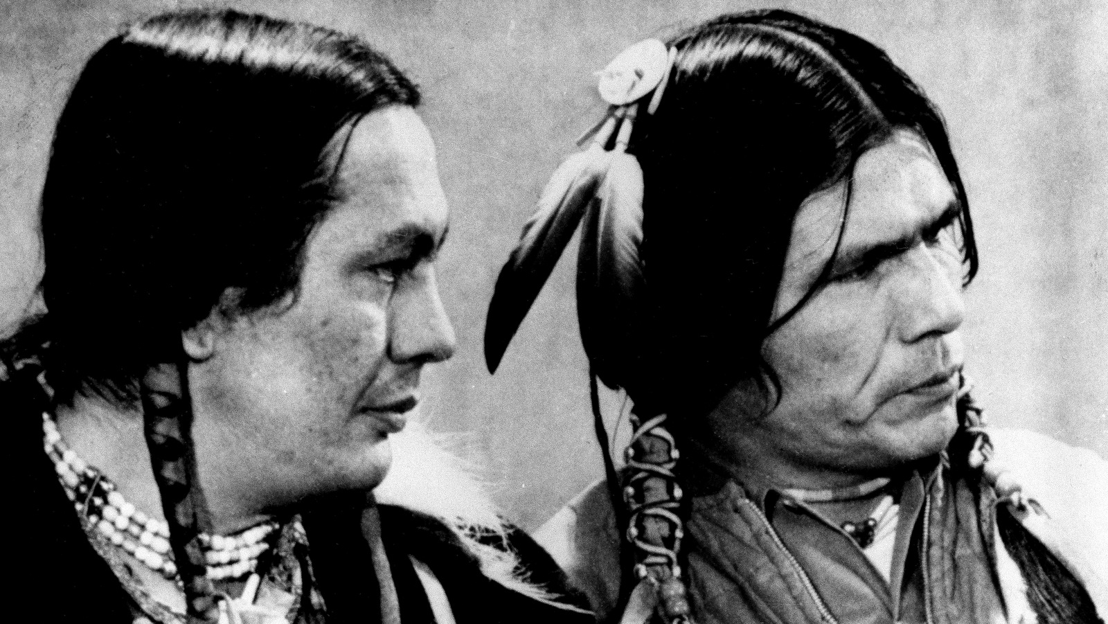 Russell Means, left, and Dennis Banks, American Indian Movement (AIM) leaders are shown on trial in St. Paul, Minn., April 12, 1974. They are on trial for the occupation of Wounded Knee, S.D. in 1973. Means and Banks say the government is on trial, not them and predict they will be victorious. (AP Photo)