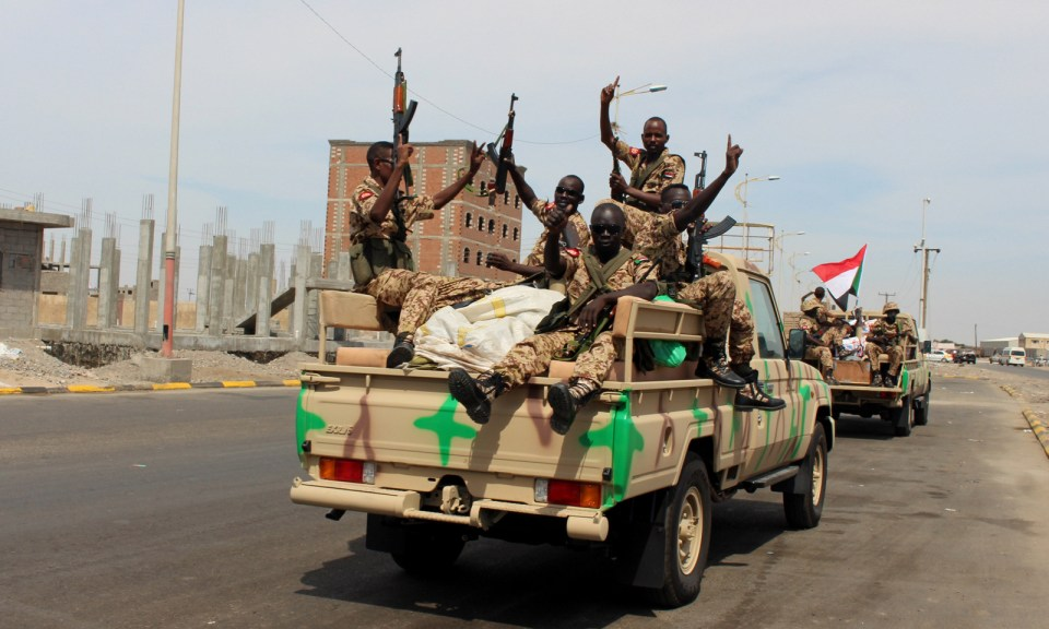 Sudanese soldiers on a military vehicle gesture as they arrive to the port city of Aden, Yemen, Nov. 9, 2015. (AP/Wael Qubady)