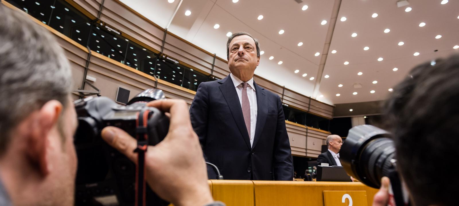European Central Bank Governor Mario Dragh arrives for a plenary session at the European Parliament in Brussels, Feb. 25, 2015. (AP/Geert Vanden Wijngaert)