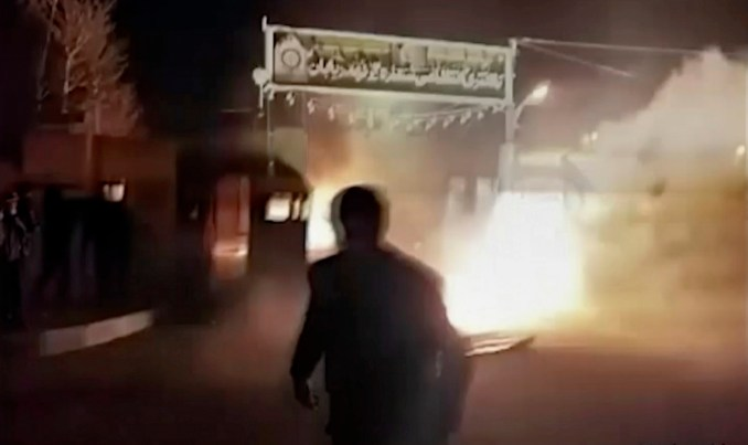 This frame grab from video shows an attack on an Iranian police station in Qahdarijan, Iran, Jan. 2, 2018. Six rioters were killed during the attack on the police station, according to Iranian state TV. It reported that clashes were sparked by rioters who tried to steal guns from the police station.