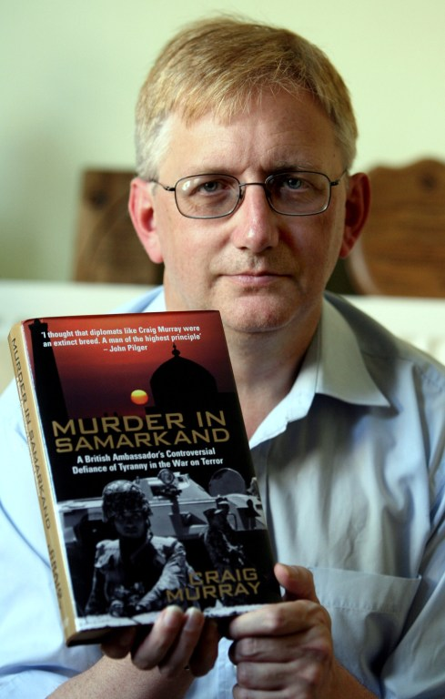 Former British Ambassador Craig Murray with his book, Murder in Samarkand. Murray was the British ambassador to Uzbekistan until he was removed from his post in October 2004 for exposing human-rights abuses by the US backed regime of President Islam Karimov. (AP/Simon Dawson)