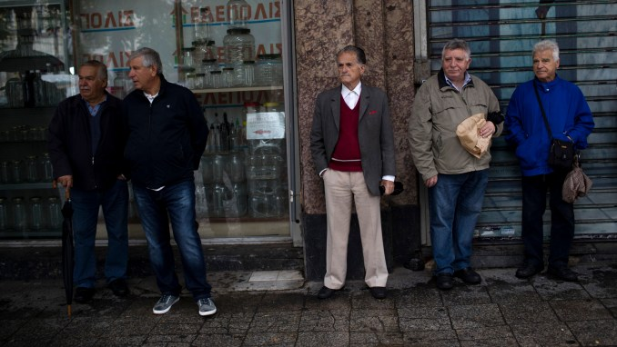 Greek pensioners stand with other retirees as they gather to take part in an anti-austerity rally in Athens. Greek retirees are struggling to survive on ever dwindling pensions with repeated cuts imposed by successive governments as part of their country's three international bailouts. (AP/Petros Giannakouris)