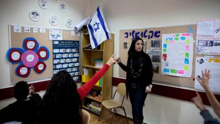 An Israeli Arab teacher from the Arab town of Kabul gives an Arabic class to Israeli schoolchildren in a school in the Jewish village of Yokneam, Dec 20, 2011. Oded Balilty | AP