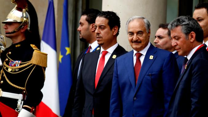 Khalifa Haftar, third left, leaves after an International Conference on Libya at the Elysee Palace, in Paris, France May 29, 2018. Francois Mori | AP