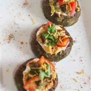 Aloo Palak Tikki Chaat on a white tray