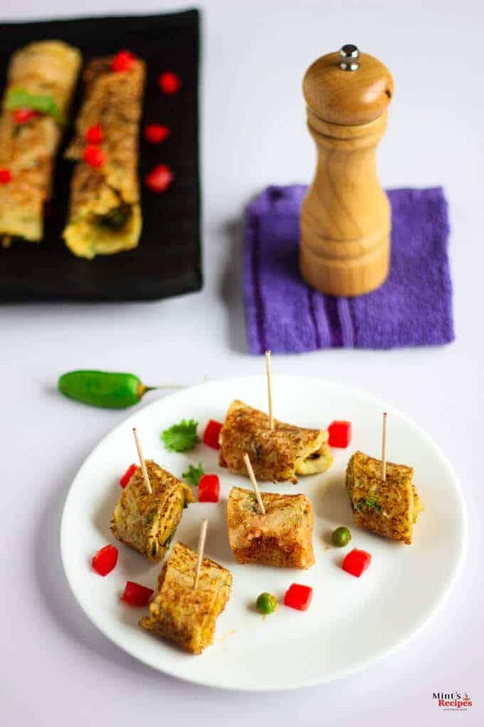 Suji Potato Rolls on a white plate with some chopped veggies | Suji Recipe