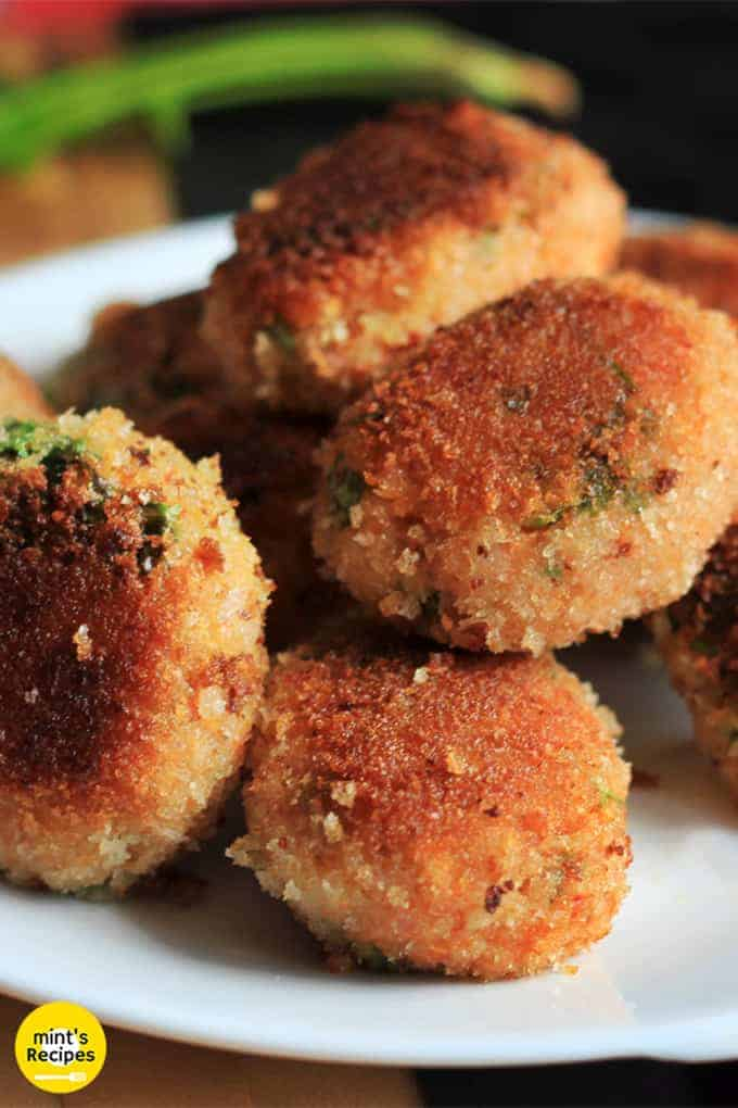 Veg Poha Cutlet on a white cutlet with some poha cutlets and a dark background |