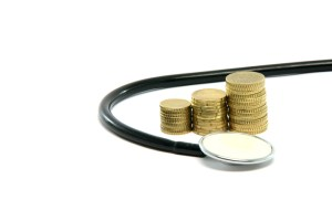 stethoscope and money isolated on white background healthcare and finance concepts