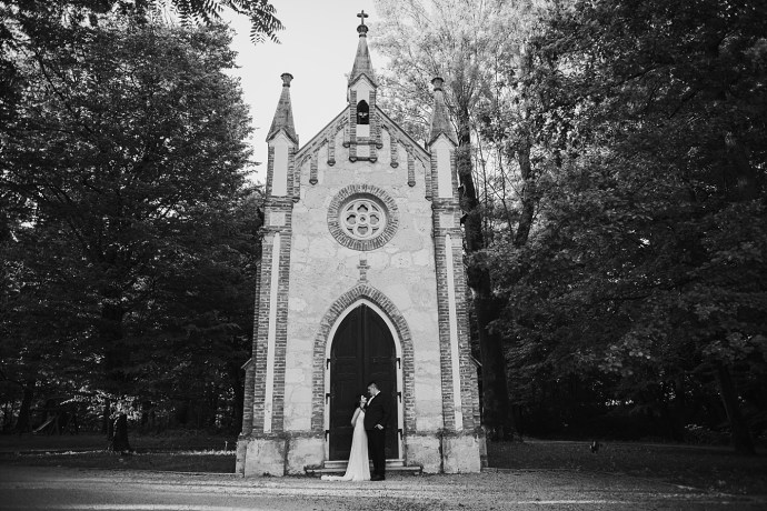 mirela bauer photography touch of love novi dvori wedding session bride and groom in front of the church